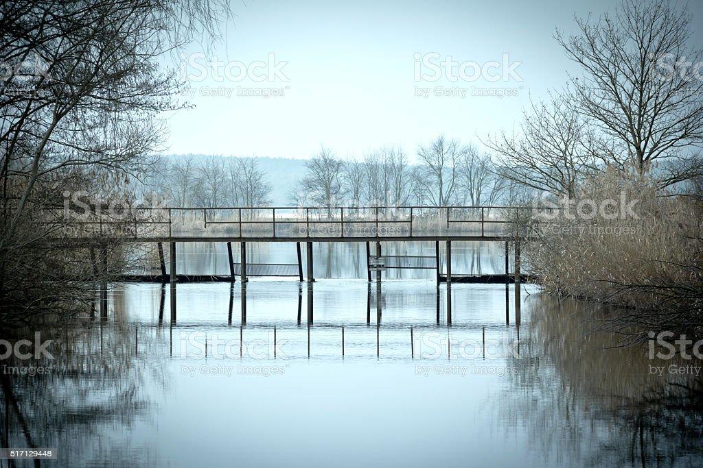 Overlooking a quiet lake in winter, Brandenburg stock photo