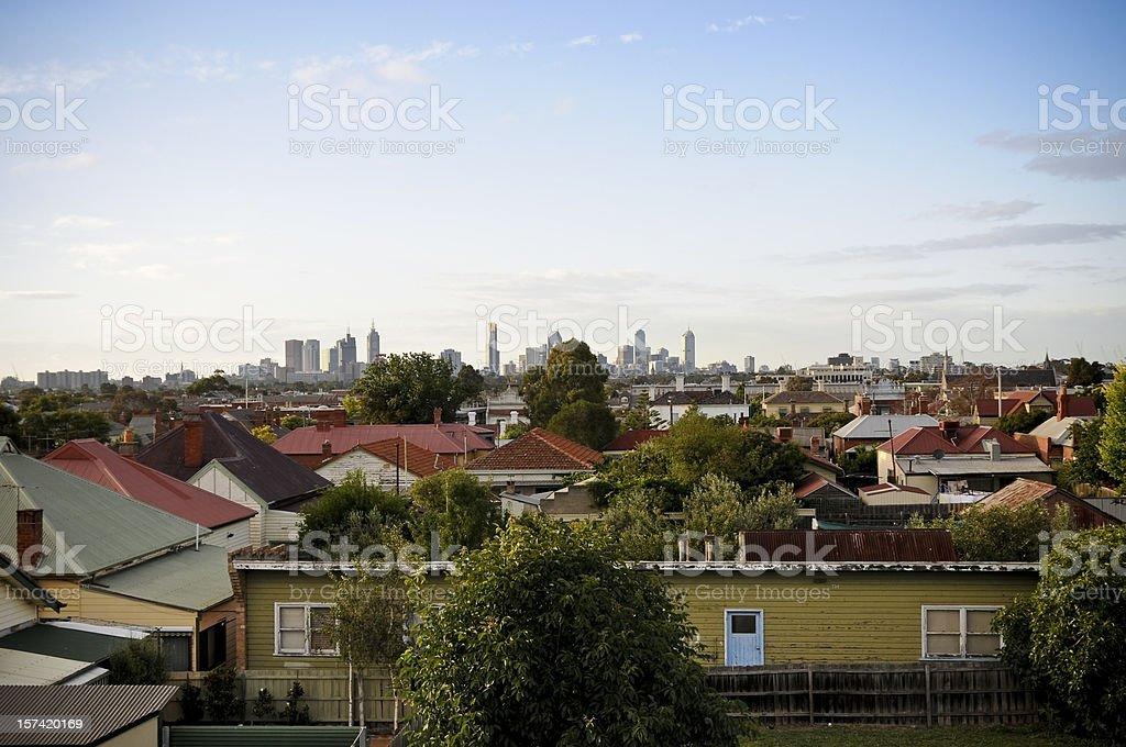 Overlooking suburban roofs towards a city skyline royalty-free stock photo