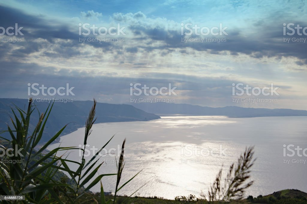 Overlooking the bay with the Strait of Messina in the far distance,Calabria,Italy stock photo