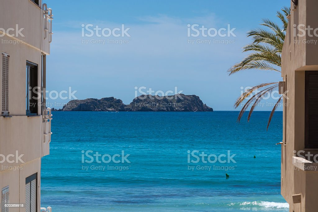 Overlooking the blue sea in the foreground a house stock photo