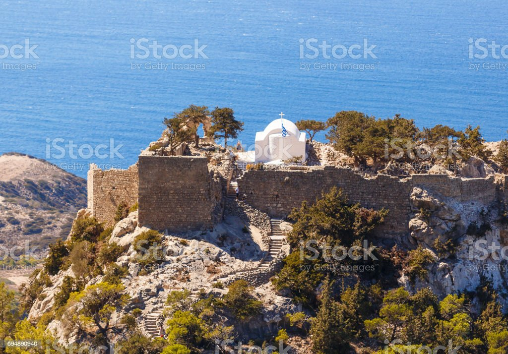 Overlooking Venetian Castle at Monolithos built in 1480 by the Knights of Saint John, Rhodes Greece Europe stock photo