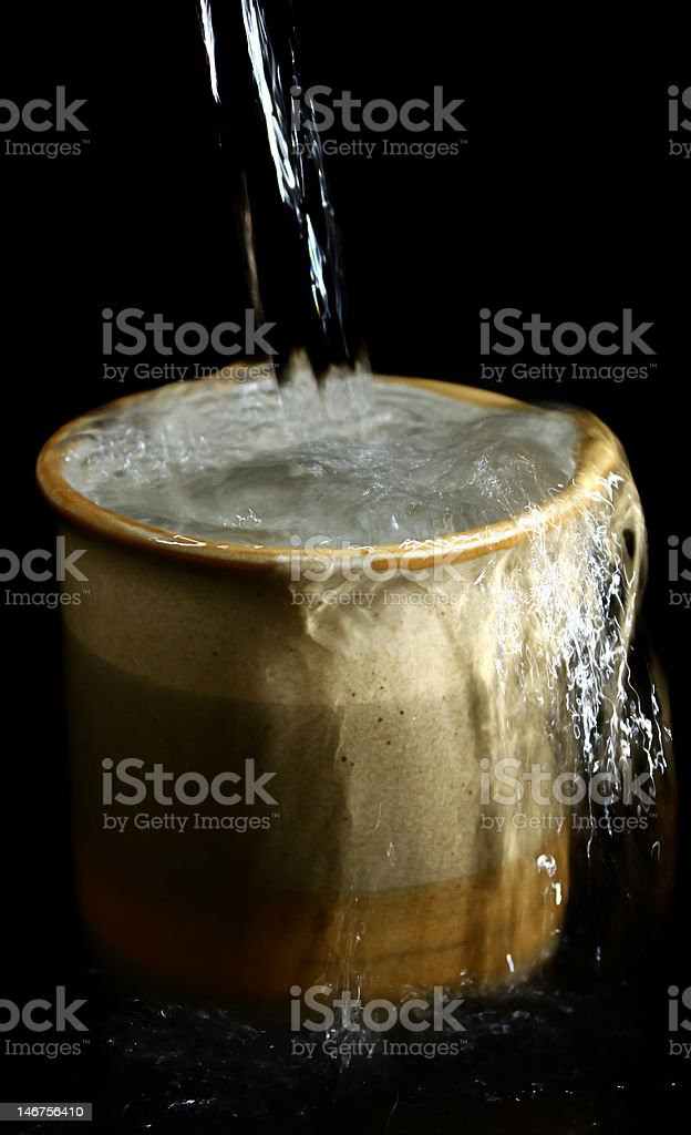 Overlowing Cup royalty-free stock photo