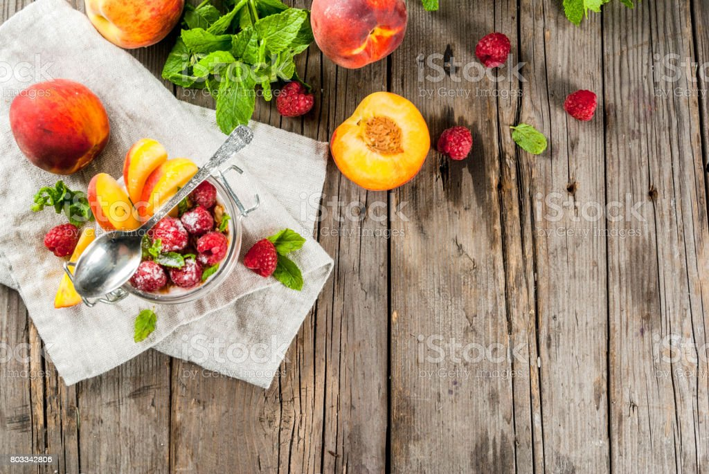 Overnight oatmeal with raspberries and peach stock photo