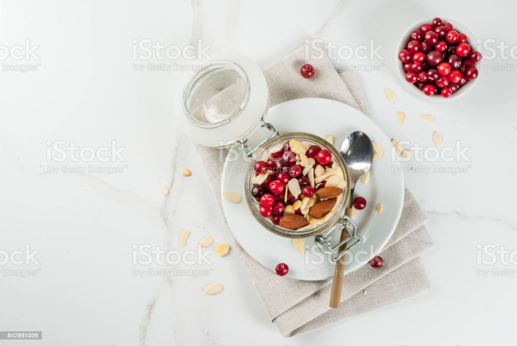 Overnight oats with almond and cranberry stock photo