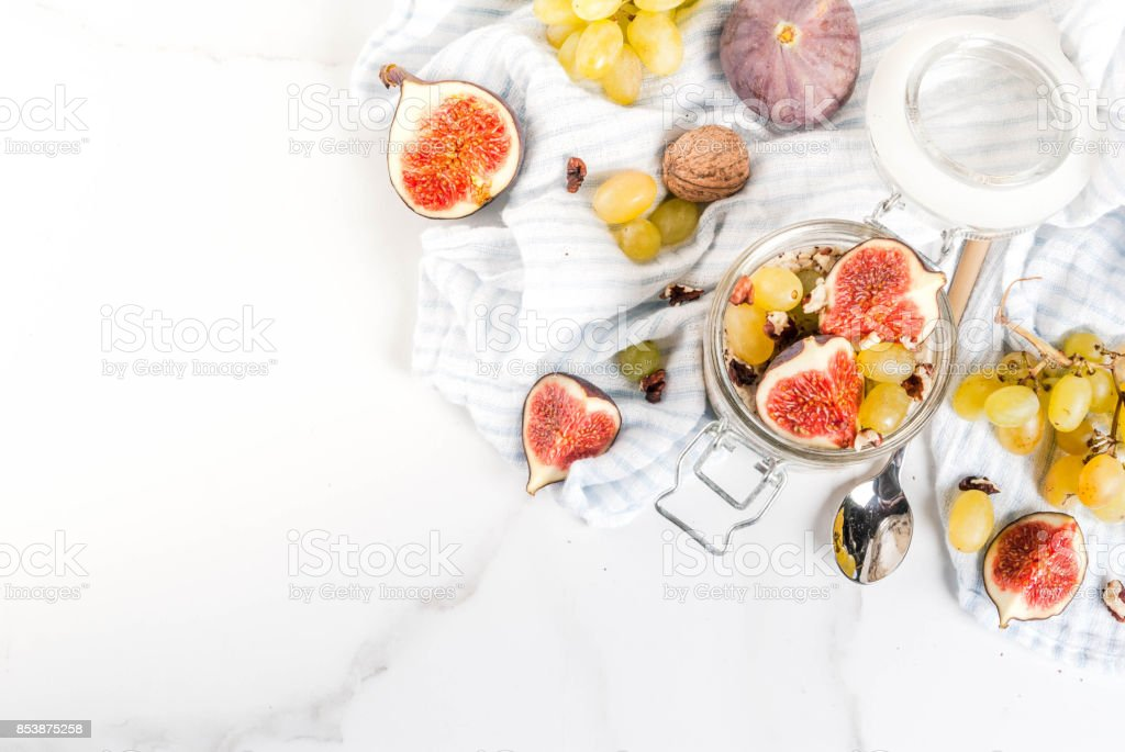 Overnight oats with figs, grapes and walnuts stock photo