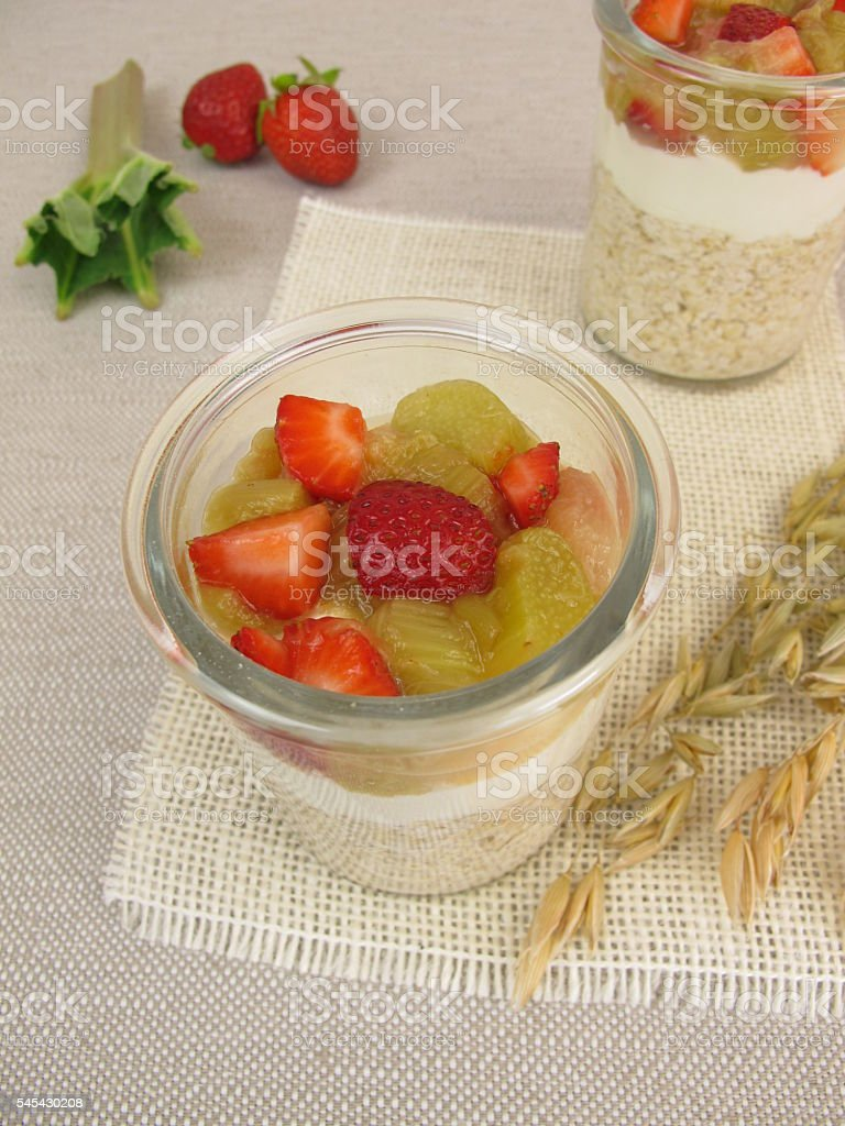 Overnight-Oats with quark, rhubarb and strawberries stock photo