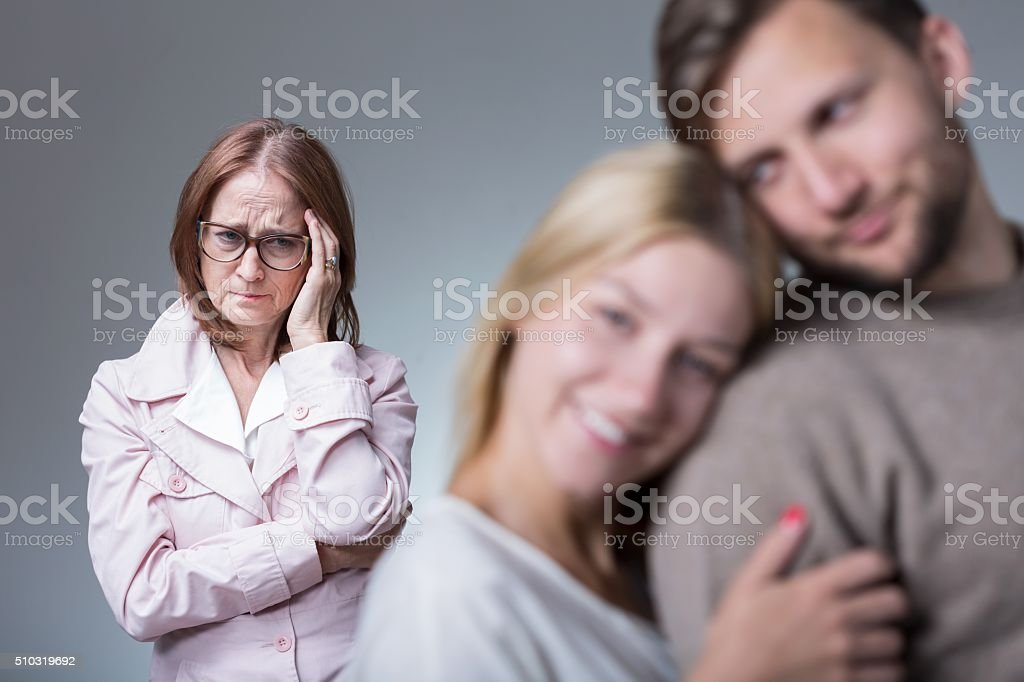 Overprotective envy mother stock photo