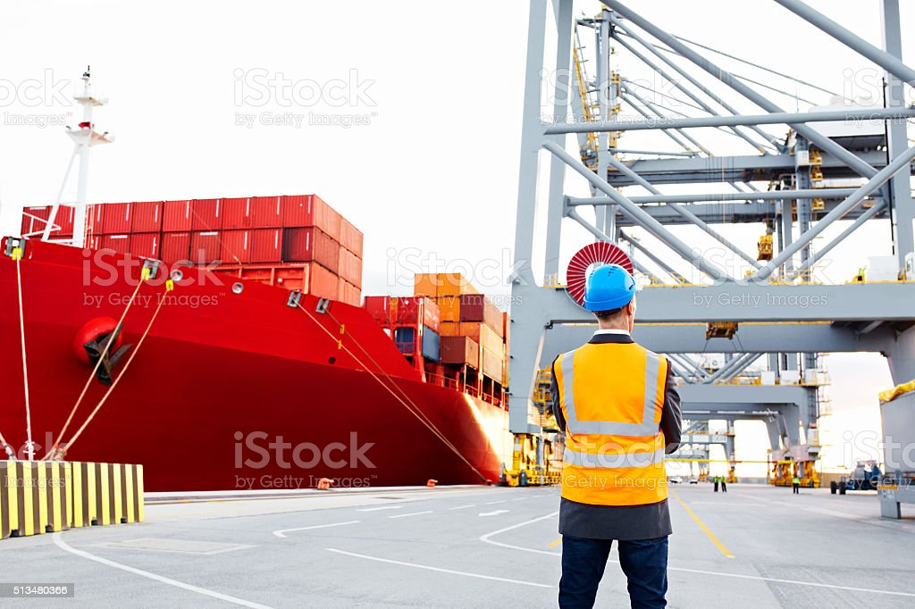 Overseeing dock operations stock photo