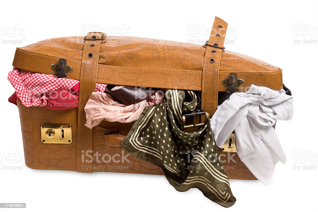 Overstuffed brown textured luggage stock photo