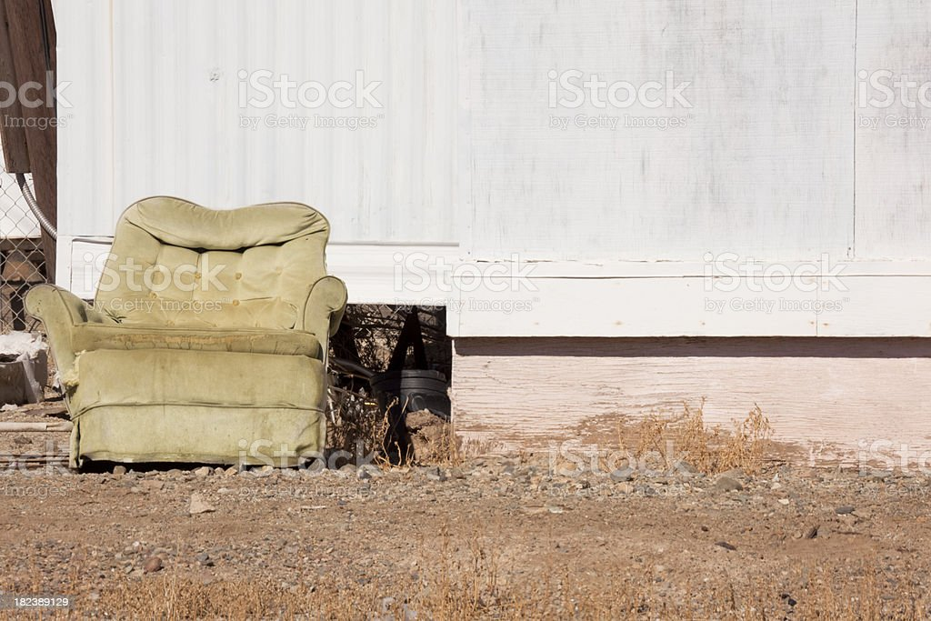 Overstuffed Chair Abandoned Outside Mobile Home, Salton Sea, California royalty-free stock photo
