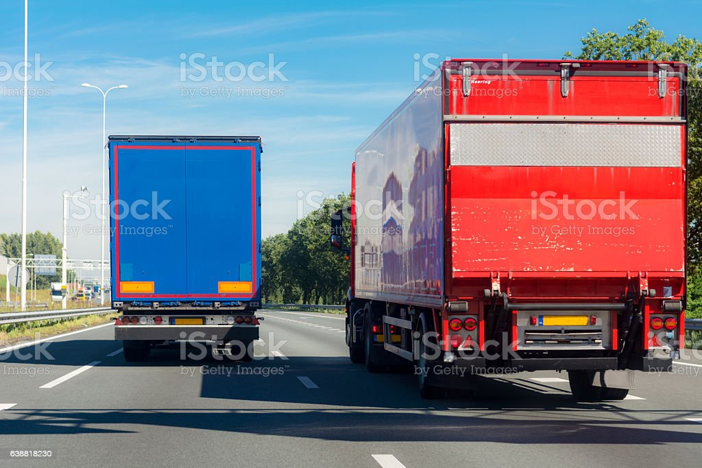 Overtaken by a large blue truck on the freeway stock photo