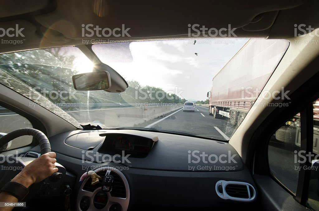 Overtaking a truck on a highway stock photo