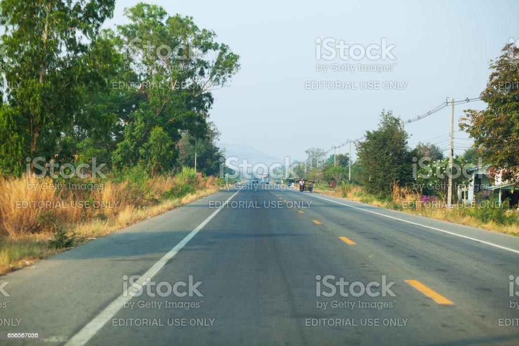 Overtaking scene on road in Kanchanaburi stock photo