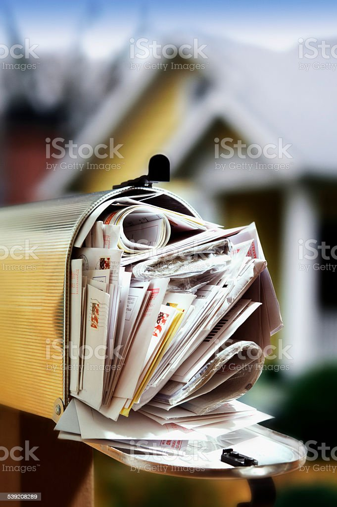 Overtuffed Mailbox stock photo