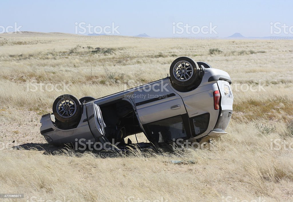 Overturned car in Remote Area stock photo