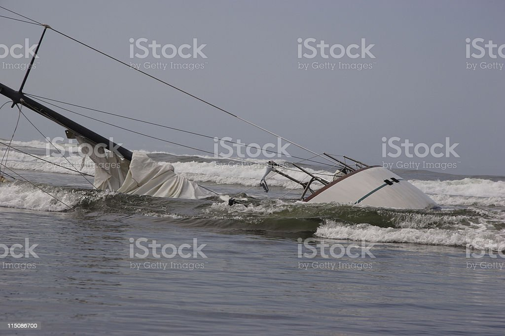 overturned sunk sailboat royalty-free stock photo
