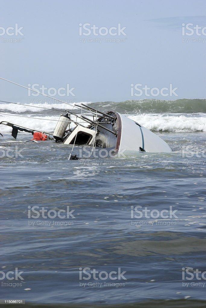 overturned sunk sailboat stock photo