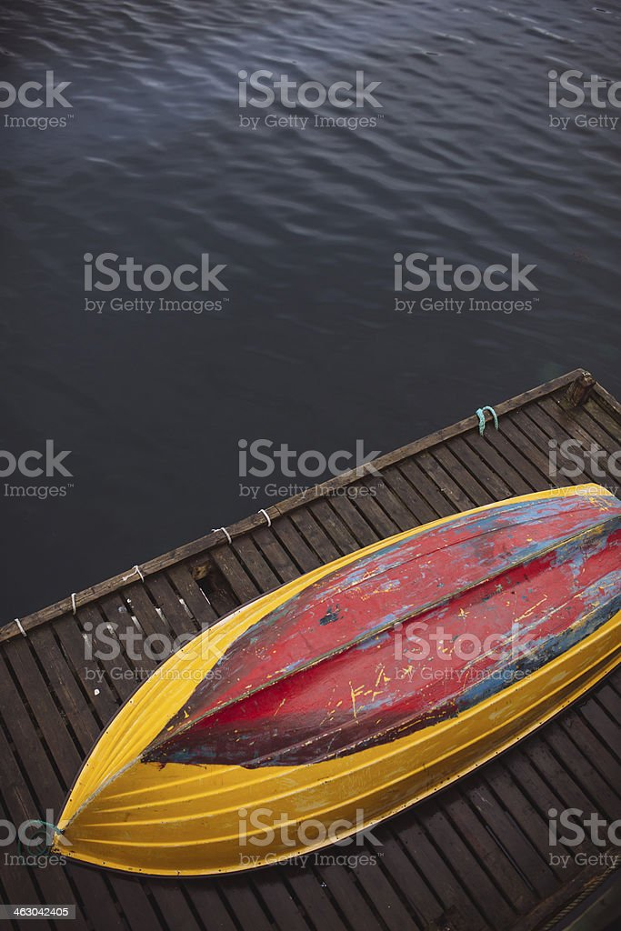Overturned Yellow and Red Row Boat - Lofoten Islands, Norway royalty-free stock photo