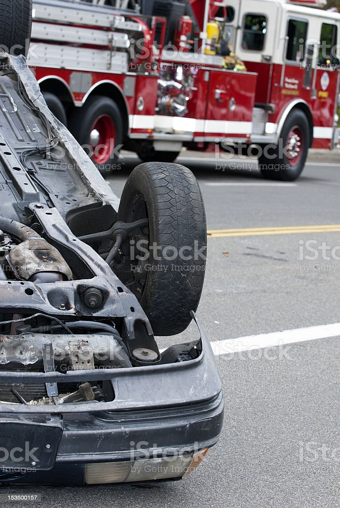 OverturnedCarandFireTruck stock photo