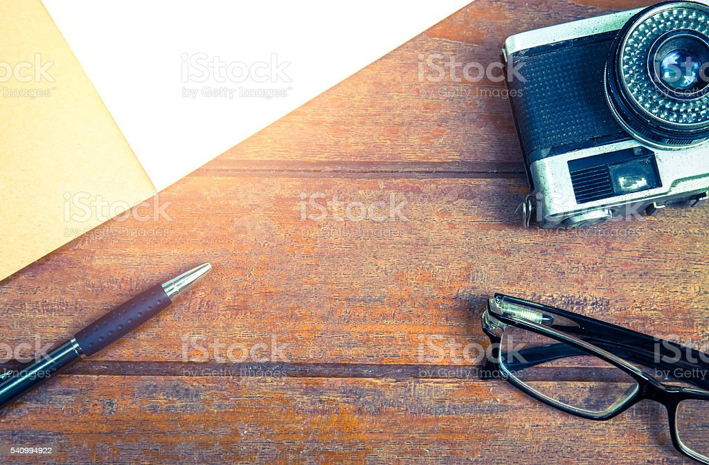 Overview desk of designer with notebook,glasses,pen and camera stock photo