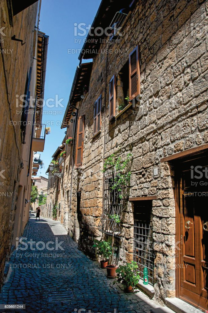 Overview of an alley with old buildings and wooden door in Orvieto stock photo