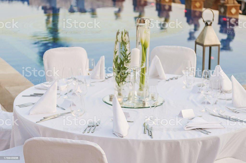 Overview of elegant white wedding reception table setting stock photo