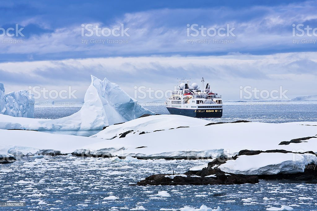 Overview of large cruise ship sailing through icy waters stock photo