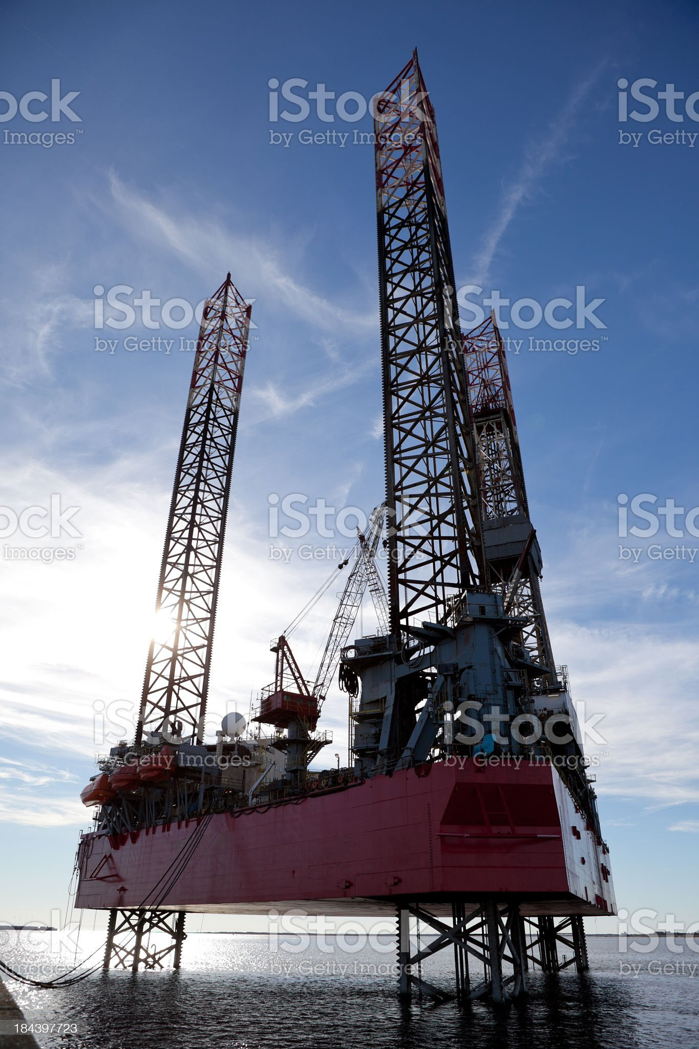Overview of ocean oil rig at sunset royalty-free stock photo