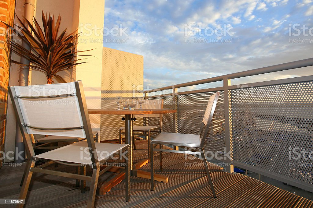 Overview of patio furniture on balcony royalty-free stock photo