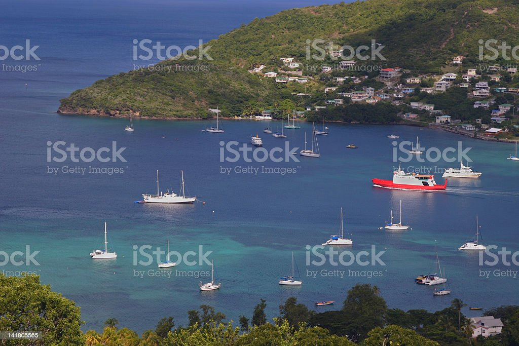 Overview of ship in the harbor at Admiralty Bay stock photo