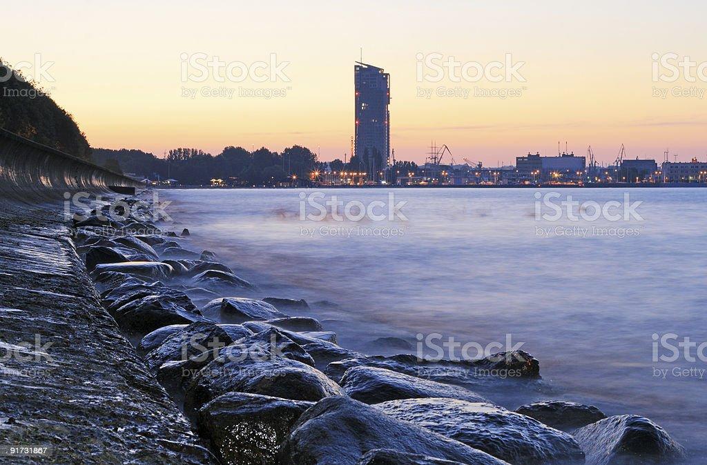 Overview of stony coastline at sunset stock photo