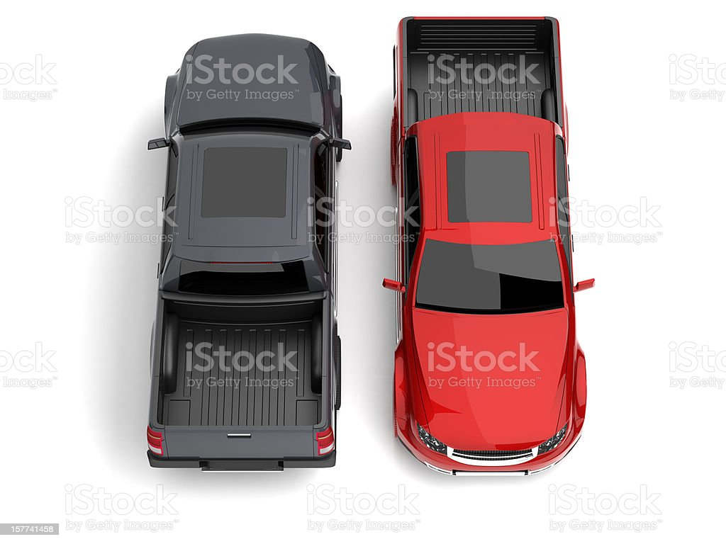 Overview of two pick-up trucks, one black and one red stock photo