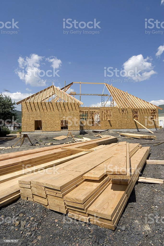 Overview of wooden skeleton of new home construction royalty-free stock photo