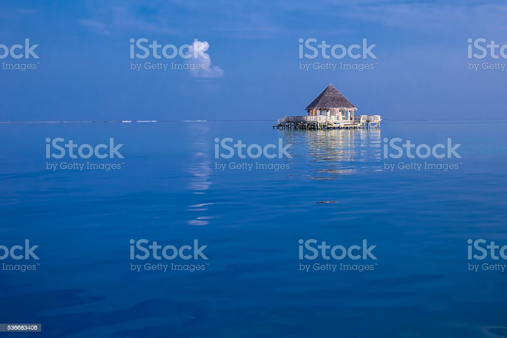 Overwater bungalows with tourquise clear water stock photo