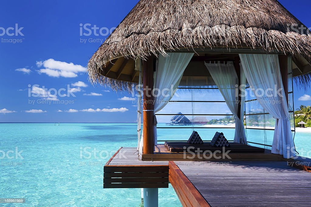 Overwater spa in lagoon around tropical island stock photo