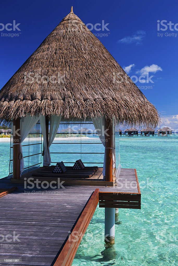 Overwater spa in lagoon around tropical island stock photo