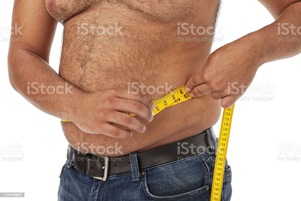 Overweight African American Man Measuring Waist stock photo