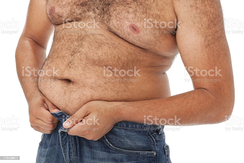 Overweight African Man Attempting to Button Jeans royalty-free stock photo