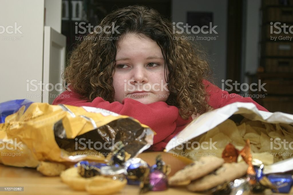 Overweight Child with Junk Food stock photo