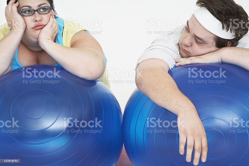 Overweight Couple Resting on Exercise Balls royalty-free stock photo