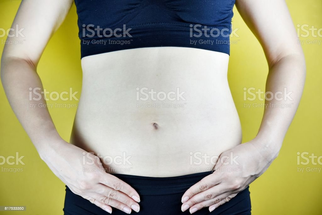 Overweight fat woman, Middle-aged woman with excessive belly fat. (Selective Focus) stock photo