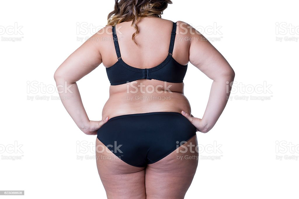 Overweight female body, fat woman with cellulitis isolated on white stock photo
