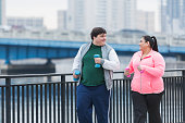 Overweight Hispanic man and woman exercising together