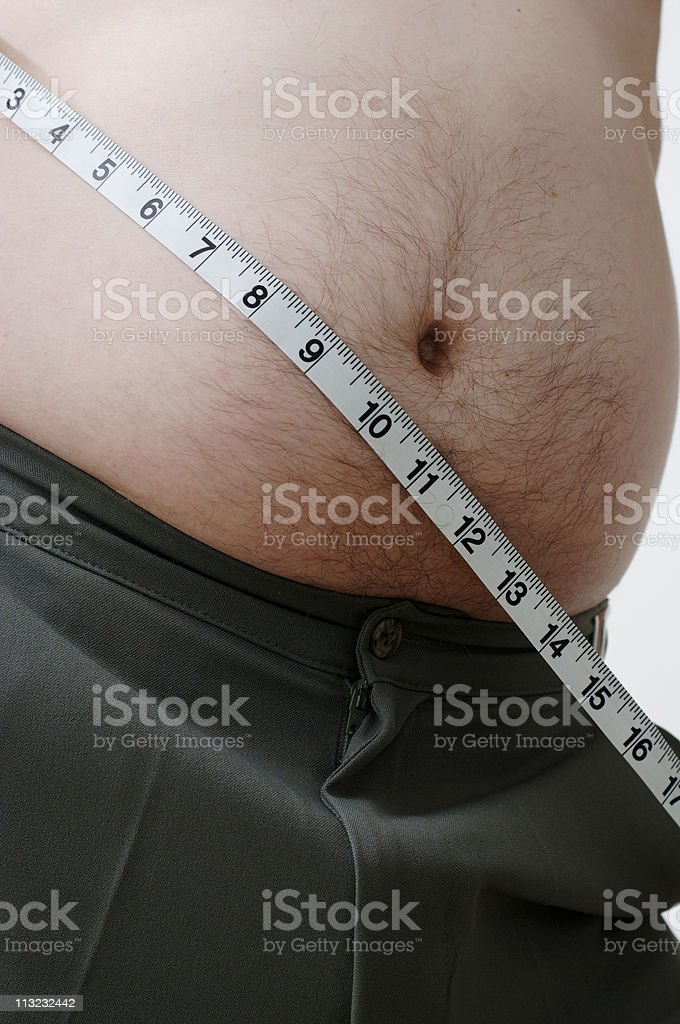 overweight male stomach with tape measure royalty-free stock photo