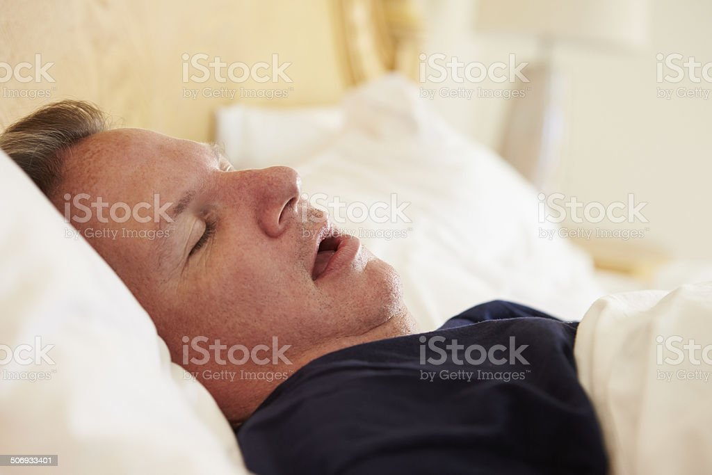 Overweight Man Asleep In Bed Snoring stock photo
