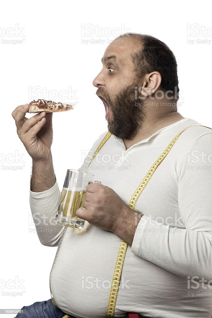 Overweight man eating pizza and drinking beer royalty-free stock photo