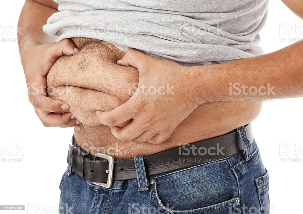 Overweight Man Grabbing His Gut stock photo