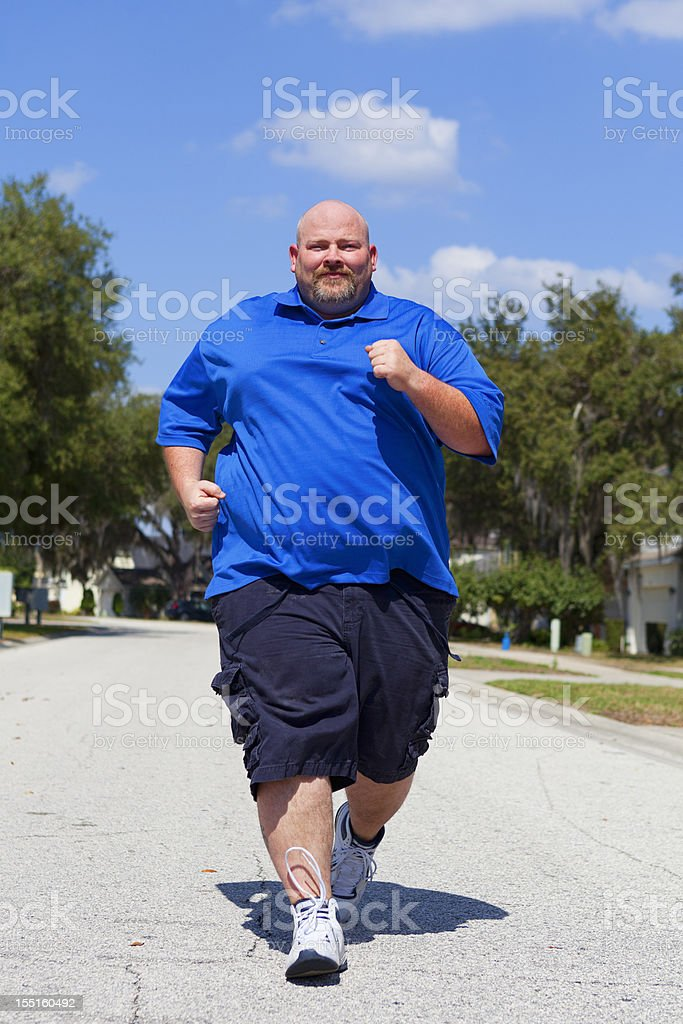 Overweight Man Jogs Down the Street royalty-free stock photo