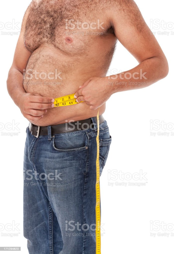 Overweight Man Measuring Waist royalty-free stock photo