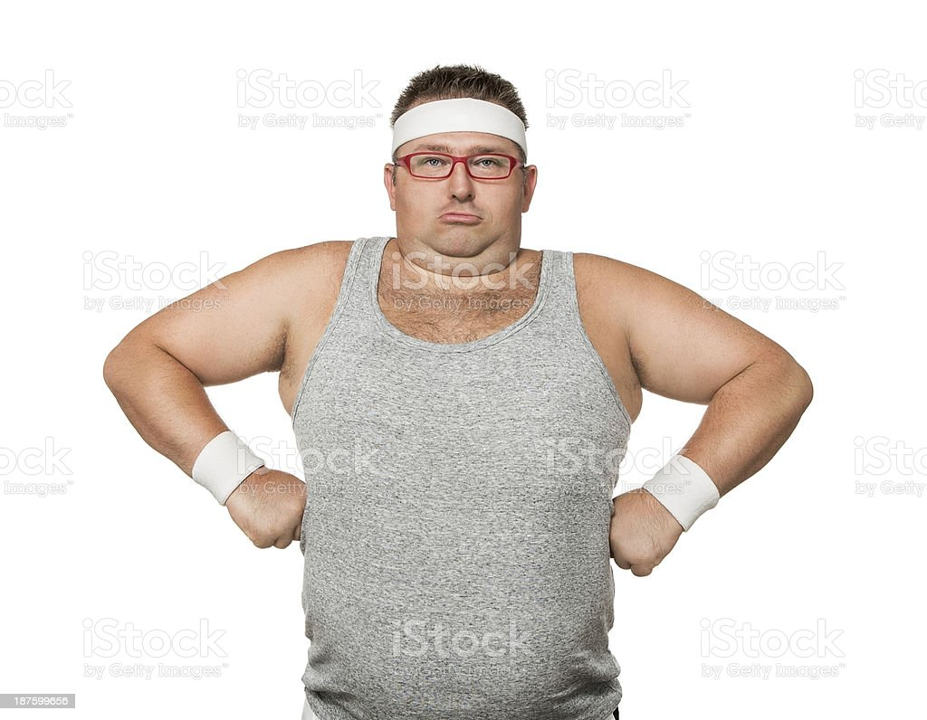 Overweight man pulling funny faces whilst attempting sport stock photo